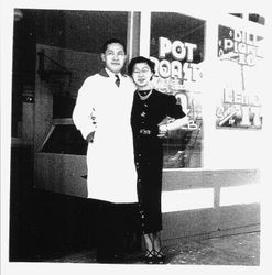 Paul Dunn and friend in front of Paul's Market, Graton, about 1930s