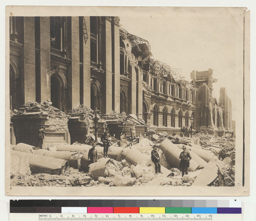 Fallen pillars of the City Hall. San Francisco. [Police officers posing among ruins.]