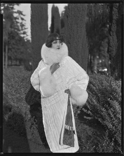 Actress (?) modeling an ermine (?) coat, circa 1930-1931