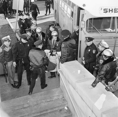 Arrested students being loaded into sherriff's bus before being taken to jail
