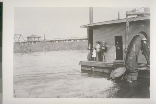 [Unidentified people at pump station. Middle River.]