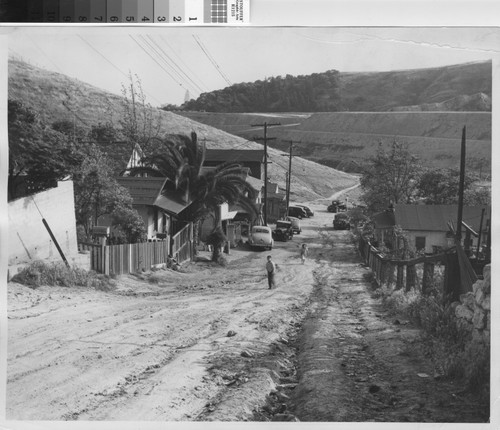 Photograph of two children walking up a hill in Chavez Ravine