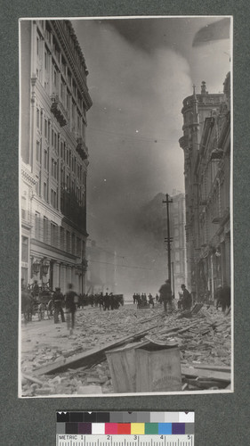 [Montgomery St. looking south toward Market St. during fire. Burning of Palace Hotel in distance.]