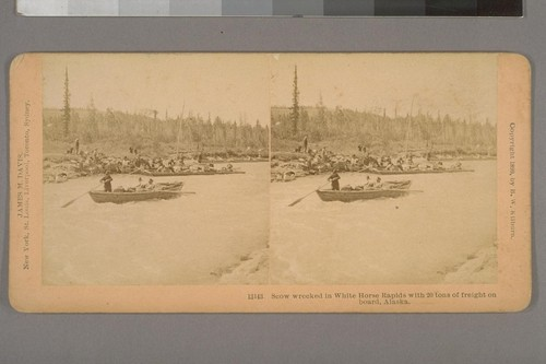 Scow wrecked in White Horse Rapids with 20 tons of freight on board, Alaska. [Yukon gold rush]