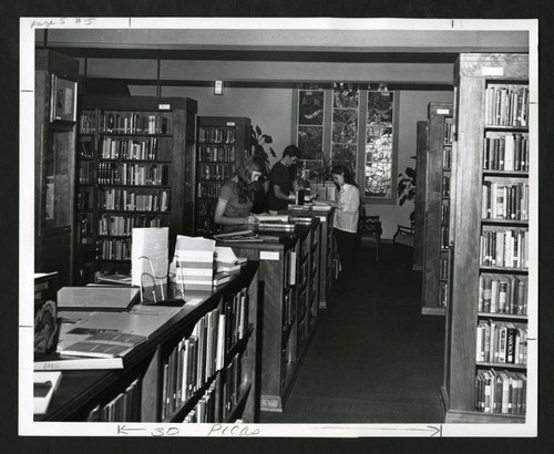 Students study amongst the myriad of bookcases in Denison Library, Scripps College