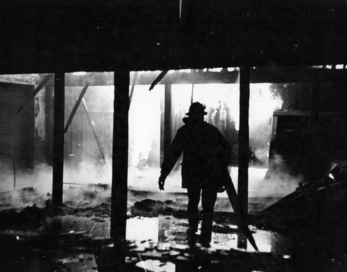 Fireman is framed by flames that swept Van Nuys market