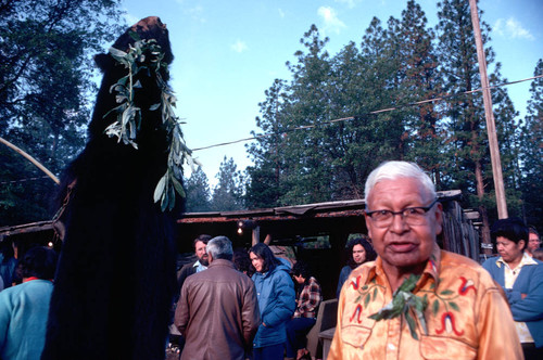 Frank Joseph next to the bearskin at the Janesville Bear Dance--1977