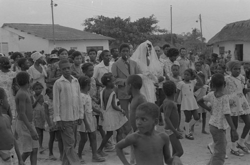 Wedding couple walking in the street, San Basilio de Palenque, 1976