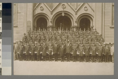 [Group portrait of police officers. First Presbyterian Church. Unidentified location. Photograph by Max W. Greene.]