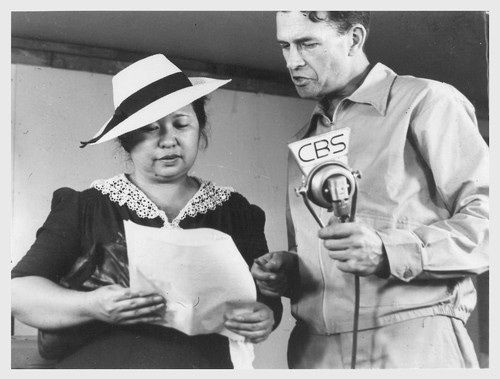 Poston, Ariz.--Mrs. Lyle Kurisaki, evacuee of Japanese ancestry, and Norris James, WRA official, in an interview at this War Relocation Authority center during a CBS nationwide hookup.--Photographer: Clark, Fred--Poston, Arizona. 5/26/42