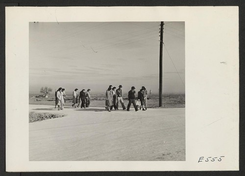 5:00 P.M. and the administrative office workers trek home to their barracks. Photographer: Parker, Tom Amache, Colorado