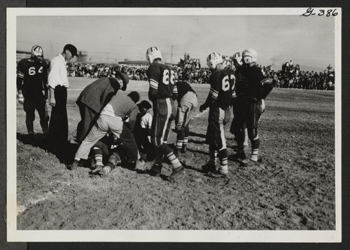Casualty in the ranks of Topaz football team during game with Fillmore High School at Topaz Relocation Center November 11, 1943. Topaz, Utah