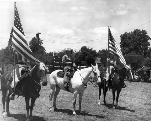 Three members of California Centaurs mounted junior drill team at the Boyes Hot Springs Horse Show in 1946 with Hogback Mountain in the background