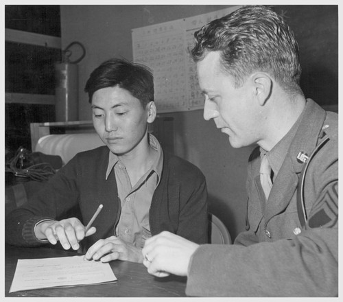 A serious moment for this 21-year-old Japanese-American, for he has just signed voluntary enlistment papers which puts him into a