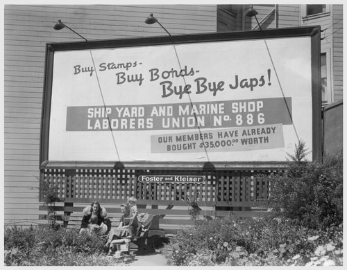San Francisco, Calif. (Sutter and Octavia St.)--Billboard advertisement at edge of Japanese quarter, photographed on morning when 600 persons of Japanese ancestry from this section were evacuated to an assembly center. Photographer: Lange, Dorothea San Francisco, California