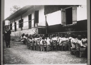 A Junior School class in Akropong doing hand-work (plaiting palm-leaves and fibres)