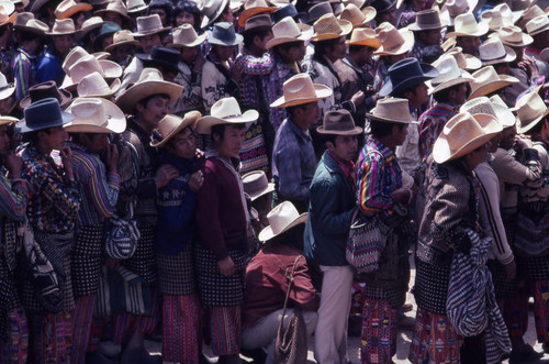 A crowd of Mayan men waiting in line to vote, Sololá, 1982