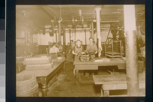 [Factory workers making chocolate bars.]
