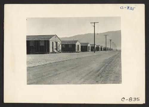 Manzanar, Calif.--Street scene of barrack homes at this War Relocation Authority center for evacuees of Japanese ancestry. Photographer: Lange, Dorothea Manzanar, California