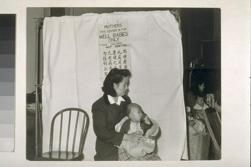 [Woman with infant at child care center.]