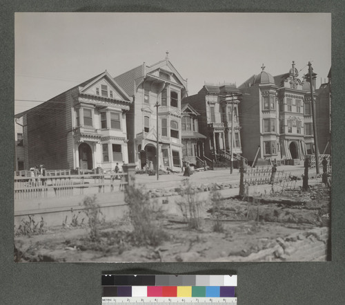 [Tilted wooden-frame houses, Howard St. between Eighteenth and Nineteenth Sts.] [Now South Van Ness Ave.]