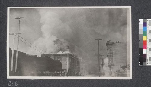 Fire approaching Ex-Mayor Phelan's residence on Valencia Street on April 19, 1906. The fire is here shown at Sixteenth and Valencia Streets. Mayor's residence is at left