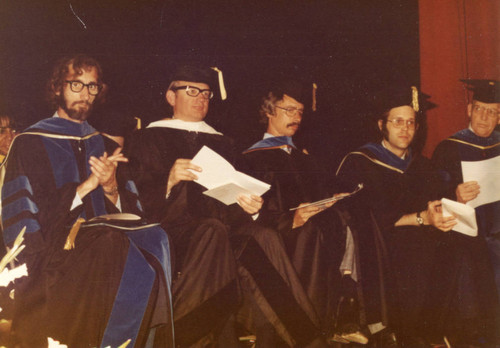 Los Angeles Campus Faculty at Commencement--L to R: Dr. Truman Clark, Unknown, Dean Grover Goyne, Dr. Robert Sanders, Graduate Dean Frank Pack
