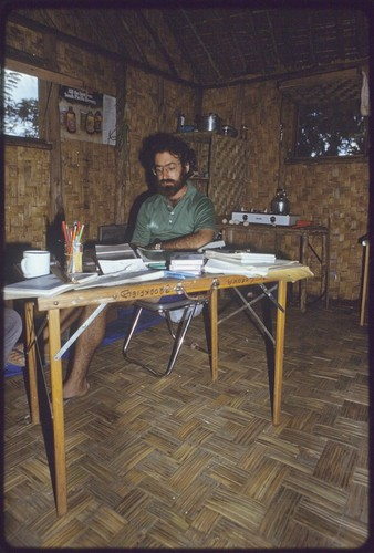 Western Highlands: anthropologist William Heaney working at a folding table