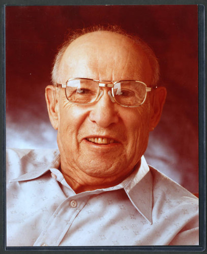 Close-up color portrait photograph of Peter Drucker