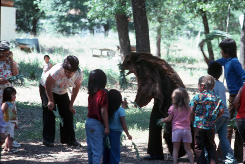 Children gathered around bear impersonator at the Greenville Bear Dance--1981