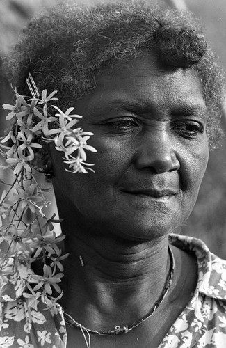 Woman with flowers behind her ear, San Basilio de Palenque, 1977