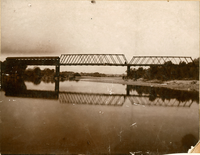Looking down stream upper Oroville & Thermalito county bridge taken about 1889. First span is covered, on Oroville side. W.R. Parker