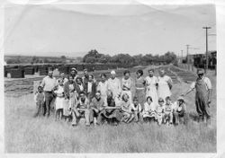 Group of O. A. Hallberg & Sons workers behind the cannery in Graton, California, about 1930s