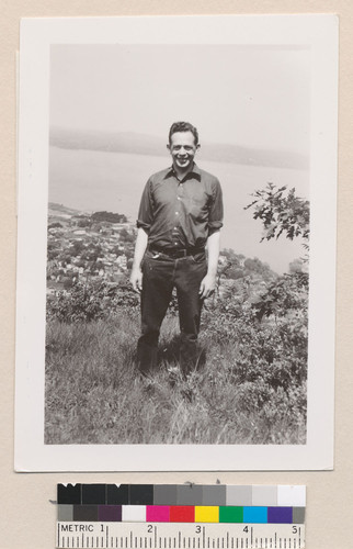 [Robert Marshall standing on a hill top.]