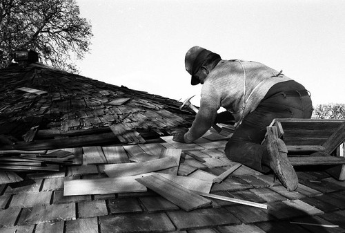 Ernest Burrows working on roof of the Grindstone Round House