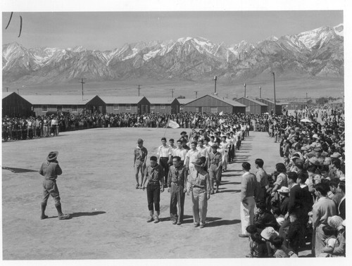 Manzanar, Calif.--Memorial Day services at Manzanar, a War Relocation Authority center where evacuees of Japanese ancestry will spend the duration. American Legion members and Boy Scouts participated in the services. Photographer: Stewart, Francis Manzanar, California