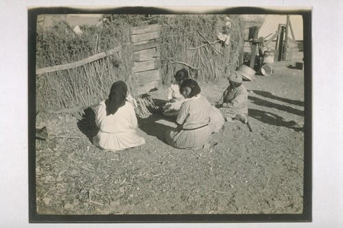 The Shoshone Indian Squaws playing a game by the Wickiup