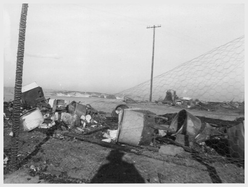 47 electric washing machines were destroyed in a Christmas night 1943 blaze in Block 202, Poston Unit II. Two mangles, 29 gas stoves, 8 electric refrigerators and an electric stove also were destroyed. The buildings served as warehouses for evacuee and personnel household goods.--Poston, Arizona. 12/25/43