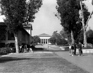 Two groups of students congregate on the campus of Occidental College