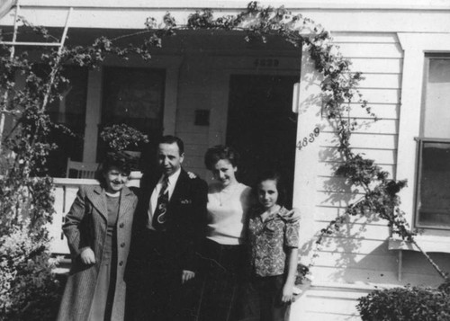 Armenian American family in front of home