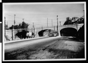 Concrete viaduct crossing a street and railroad tracks