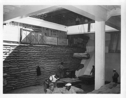"[unlabeled] 10/16/47 shot from inside hold. Stacked ""Santa Clara"" sacks"