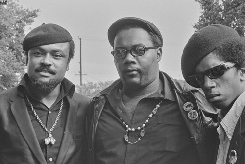 Left to Right: Black Panthers, Walter Newton, brother of Huey P. Newton, Captain Crutch and Jimmy Charley, at Free Huey Rally, Bobby Hutton Memorial Park, Oakland, CA, #50 from A Photographic Essay on The Black Panthers