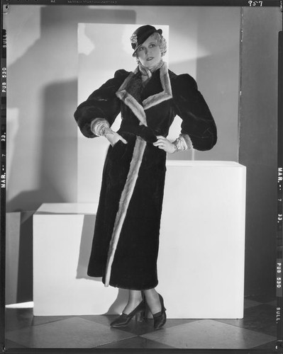 Peggy Hamilton modeling a sealskin coat trimmed in ermine, 1933