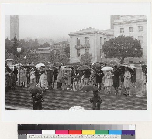 Crowd in front of Sproul Hall in rain