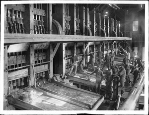 Workers in a 100-stamp mill, California, ca.1900