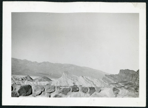 Photograph of Zabriske Point area in Death Valley with rock wall in the foreground
