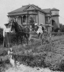 Melvin and Nellie DaVall and their son Roland Henry DaVall in their horse-drawn buggy, Melvin's mother, MaryChandler DaVall, and an unidentified woman in front of the DaVall home circa 1910 in Sebastopol