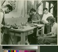 Students working with tools