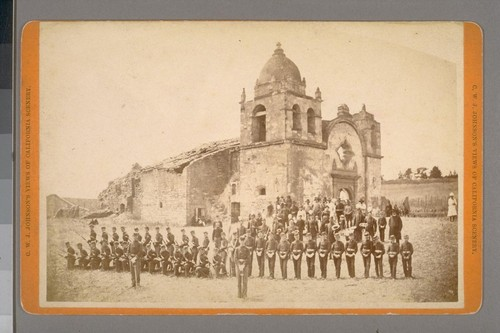 [Uniformed cadets and soldiers (?) in front of San Carlos mission, Carmel: occasion of the opening of grave of Father Junipero Serra. July 3, 1882. (Not stereographic)]